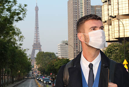 Businessman with pollution mask in Paris
